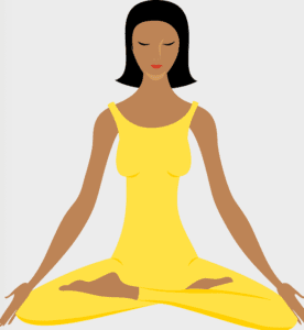 This woman is sitting crossed legged with a yellow outfit meditating, focusing on her solar plexus