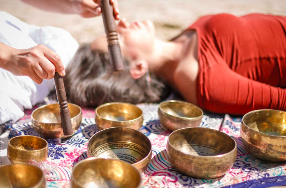Singing bowls during a sound bath experience